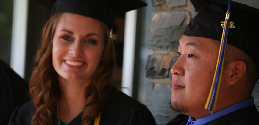 A photo of two 2015 CIU graduates. Donor scholarships allow students graduate with less debt.