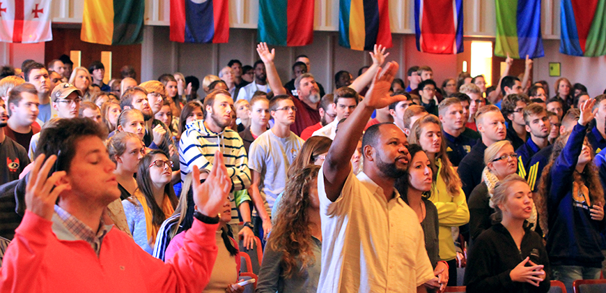 A photo of CIU students worshiping during chapel service.