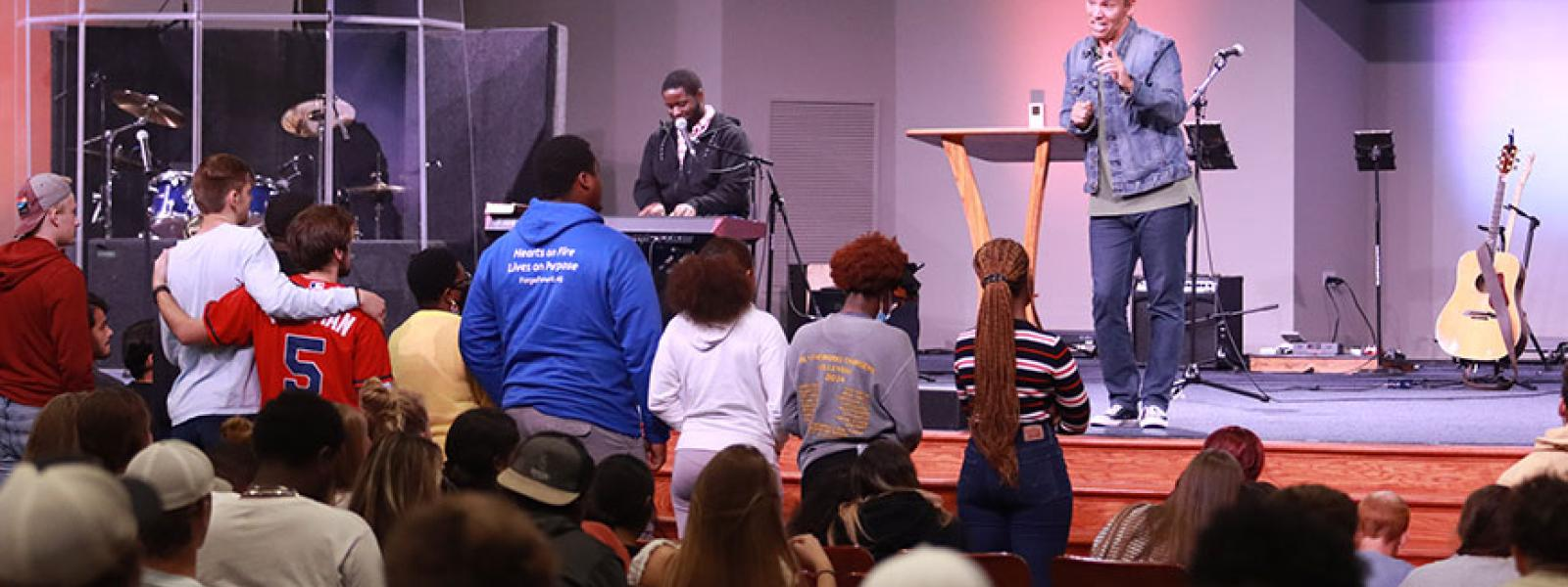Student respond to a message during the annual Christian Life Conference. (Photo by Kierston Smith)