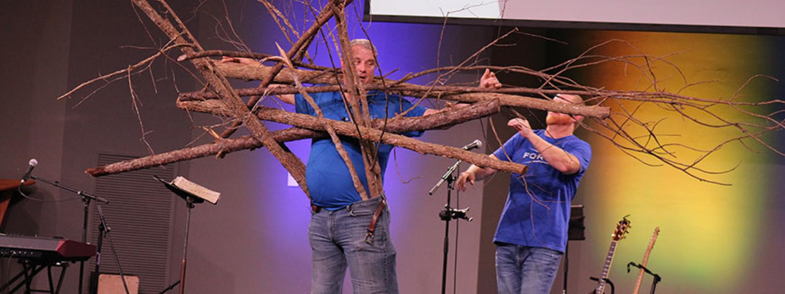 CIU alumnus Adrian Despres of Forge uses tree branches symbolizing sins to demonstrate how sin affects the Christian life.
