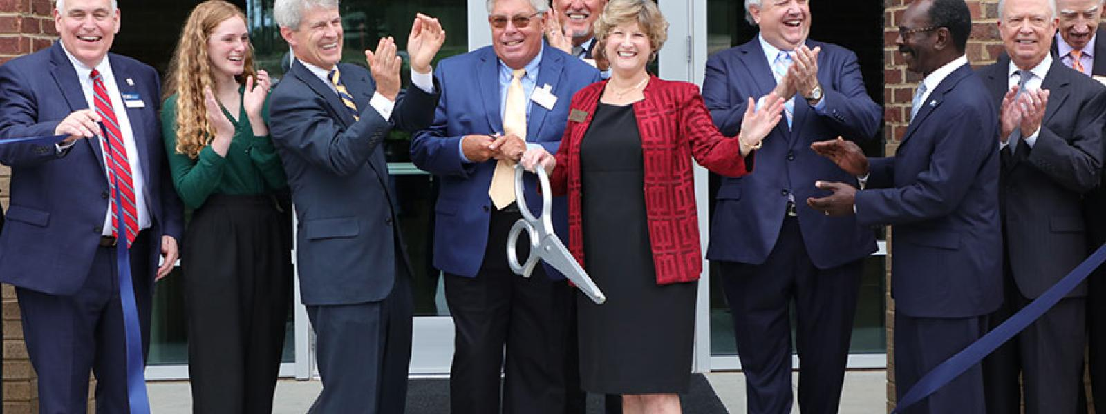 Lyn Cook cuts the ribbon on the John and Lyn Cook School of Business located in the Jones Center. (Photos by Kierston Smith)