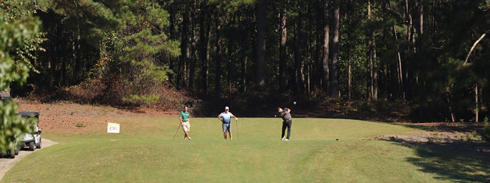 Golfers tee-off at the Columbia Country Club in the CIU Golf Classic