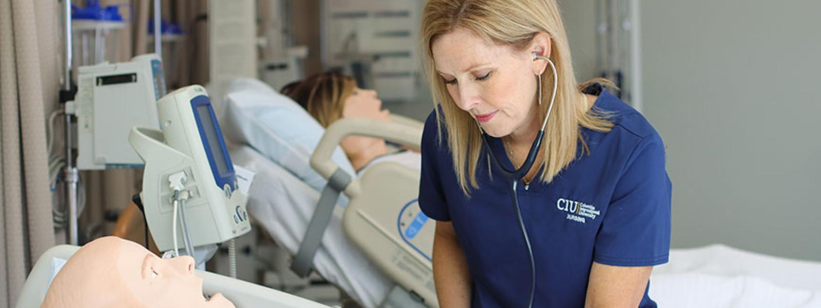 Dr. Jill McElheny with manikins in the CIU Simulation Center as she designs a proposed nursing program.